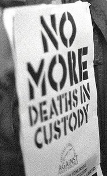 No More Deaths in Custody placard