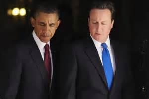 Twins of Evil. Uk Prime Minister David Cameron and American President Barack Obama plan Syria regime change